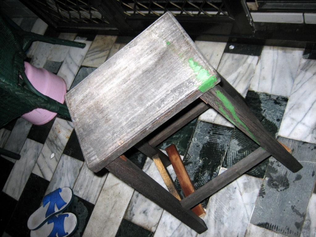 An old wooden stool that will be the legs of my table.