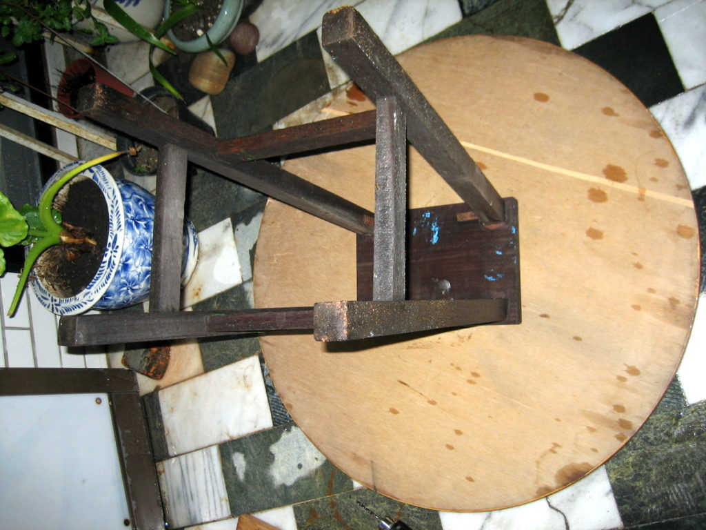 Placing the old stool onto the lazy susan top.