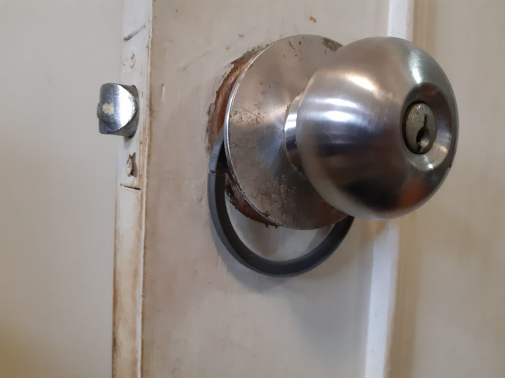 Doorknob shim assembled on doorknob